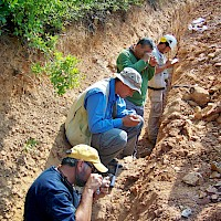 Examining and logging a fresh trench at the Akarca gold-silver project, Turkey; from front to back: Dr. Dave Johnson, Chief Geologist, Mike Sheehan, Exploration Manager-Turkey, Halil Aydincak, Sr Geologist & Alper Ozbek,Geologist